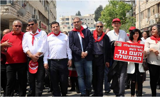 The May Day march in Nazareth, last Saturday, April 28. From right to left: Hadash MK Aida Touma-Sliman, MK Dov Khenin (holding the red sign), former Nazareth Mayor Ramez Jerayssi, Hadash's candidate for the upcoming mayoral election in Nazareth, Mus'ab Dukhan, MK Ayman Odeh, General Secretary of the CPI, Adel Amer and former MK Mohammad Barakeh (in red shirt).