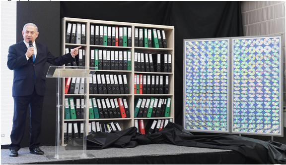 Netanyahu, last Monday, and a bookcase of empty folders purporting to illustrate the trove of Iranian files allegedly in Israel's possession about Iran's nuclear subterfuge