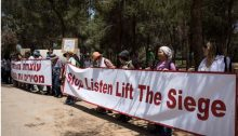 Israeli peace demonstrators near the Gaza border call for an end to the siege of Gaza, Friday, May 11, 2018.