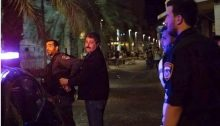 Jafar Farah, chairman of the Mossawa human rights group, being led away in handcuffs and walking on his own, still apparently uninjured, Friday night, May 18