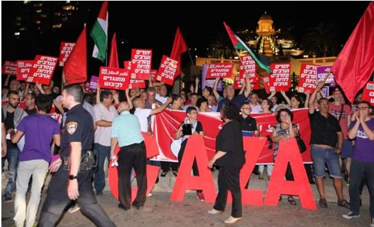 Several hundred people, Jews and Arabs, attended a protest on Sunday evening, May 20, organized by Hadash, the Communist Party of Israel, Standing Together, and Combatants for Peace in Haifa's German Colony.
