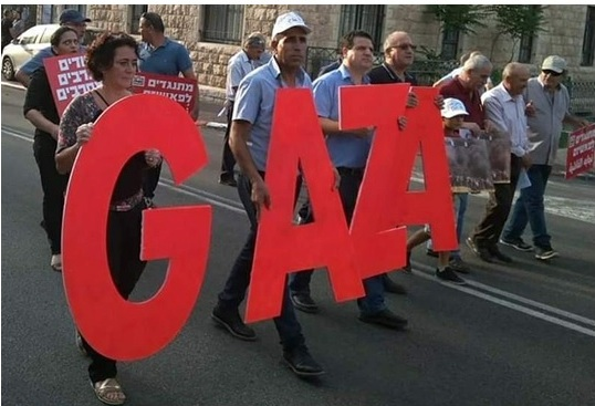 Members of Hadash and the Communist Party of Israel demonstrate in Haifa's German Colony on Friday, June 1, to display solidarity with the Palestinian people in the Gaza Strip.