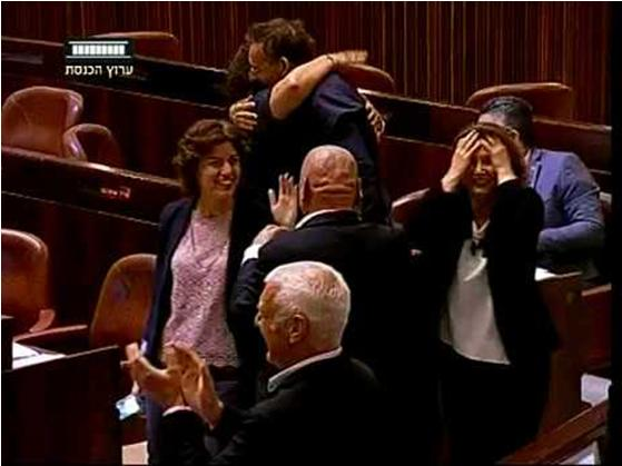 Members of the opposition cheer and congratulate one another after the bill was approved by a vote of 37 to 36.