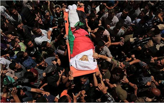 Yasser Abu al-Najja, 14, is brought to burial in Khan Yunis in the southern Gaza Strip, June 30, 2018. The youth was killed Friday by a bullet to the head fired by an Israeli sniper during a protest calling for the right of return and end to the siege of Gaza.
