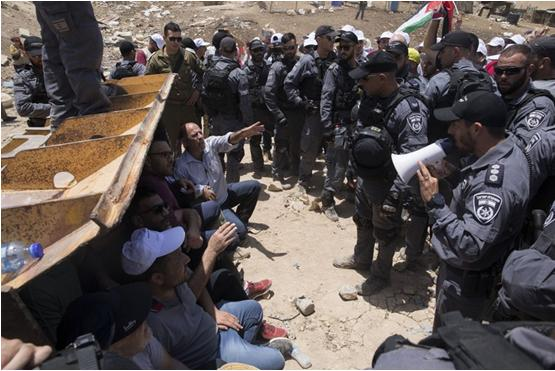 Israeli police officers and occupation soldiers confront demonstrators in Abu al-Nuwwar