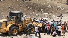 Protesters confront a bulldozer near Khan al-Ahmar, on Wednesday, July 4.