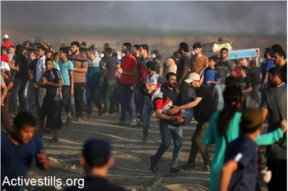 A young Palestinian demonstrator wounded by Israeli fire is evacuated from the scene along the Gaza border, Friday, July 6.
