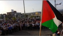 Demonstrators protest house demolitions in Sakhnin, Tuesday evening, July 24.