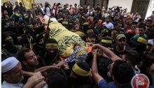 "In Gaza City mourners accompany the body of Ahmad Yaghi, 25, to burial on Saturday, August 4. Yaghi was killed by live Israeli ammunition fired during ""The Great March of Return"" protests on the eastern border of the city a day earlier."
