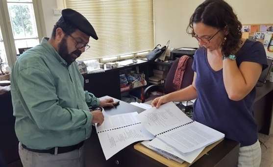 Adalah lawyers Hassan Jabareen and Suhad Bishara review their organization's petition before it is submitted to the Supreme Court.