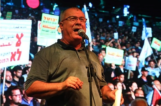 Mohammad Barakeh, Chairman of the Arab High Follow-up Committee, during the mass demonstration held in Tel Aviv, Saturday night, against the racist Nation-State Law