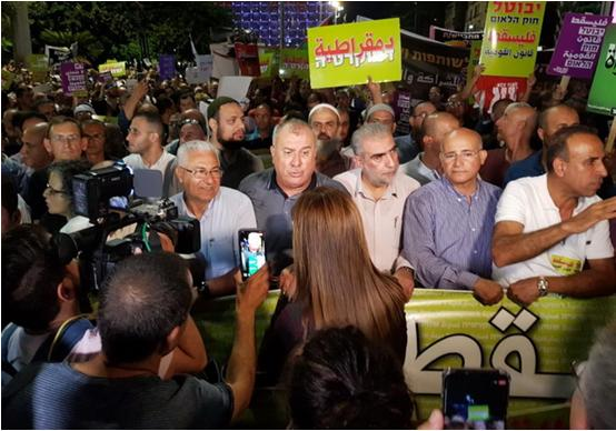 Higher Arab Monitoring Committee Chairman Mohammad Barakeh (fourth from right) during the march against the racist Nation-State Law held Saturday night, August 11, in Tel Aviv