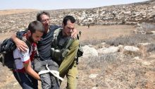 An activist from Ta'ayush being evacuated to hospital after the brutal attack by settlers at the Mitzpe Yair outpost, Saturday, August 25, 2018