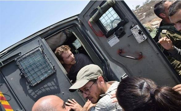 Border police detain Avner Gvaryahu, director of Breaking the Silence, on a tour of the South Hebron Hills, August 31, 2018.