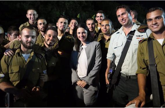 """Justice Minister Ayelet Shaked with officers and soldiers of the Golani Brigade: """"They that sow the wind, shall reap the whirlwind."""""""