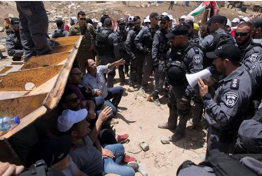 Protesters demonstrate at Khan al-Ahmar against the pending eviction of the West Bank village, July 4, 2018.