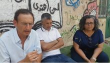 Hadash MKs Dov Khenin (left) and Aida Touma-Sliman (right) at a meeting with Khan al-Ahmar residents and peace activists, on Thursday, September 13