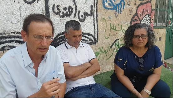 Hadash MKs Dov Khenin (left) and Aida Touma-Sliman (right) at a meeting with Khan al-Ahmar residents and peace activists, on Thursday, September 13