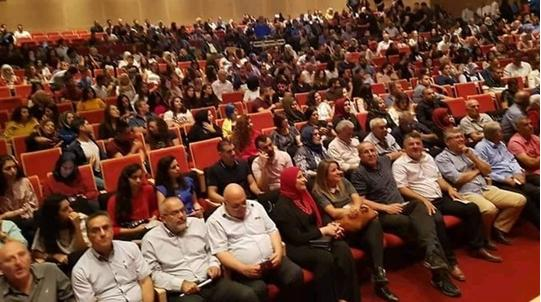 The audience attending the performance of the musical group Siraj in Umm al-Fahm, last Saturday night, September 15; among the participants (seated in the front row): Hadash MK Youssef Jabareen (fourth from right) and Hadash Chairman, Dr. Afo Agbaria (fourth from left), a former Hadash MK, and several Communist Party activists in the city.