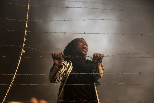 A young Palestinian woman demonstrating near the fence in the Gaza Strip, Friday, September 28