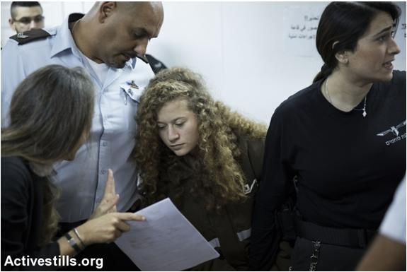 Israeli lawyer Gaby Lasky (left) confers with her client, 16 year old Ahed Tamimi (center), before a hearing at the military court in Ofer military prison, near the West Bank city of Ramallah, January 15, 2018.