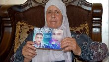 Na'ama Handi with photo of her son Raed whom she has not seen since the end of 2017
