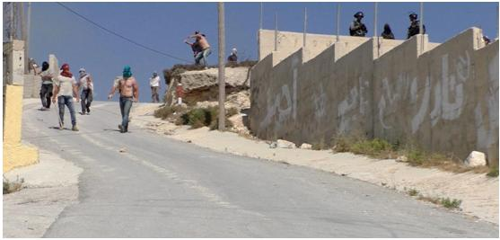 Hooded Israeli settlers assault 'Urif while military looks on, covering them, July 6, 2018
