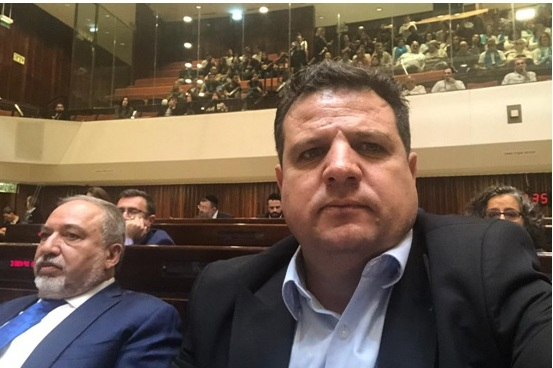"""Musical chairs"": A selfie posted by MK Ayman Odeh to his Twitter feed showing himself sitting grim-faced in the Knesset plenum next to his new neighbor, the racist Avigdor Lieberman."