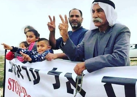69-year-old Sheikh Sayekh Abu Madi'am al-Touri, right, and family members during a demonstration against the demolition of the Bedouin village of Al-Araqib, unrecognized by the State of Israel