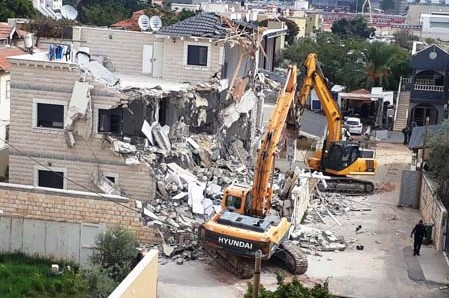 State deployed bulldozers demolish the three-story home that belonged to the Shaaban family in Lod.