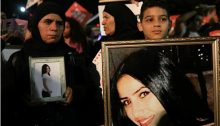Relatives of the late Samer Khatib, a victim of male violence, display photographs of her during the mass rally held in Rabin Square in Tel Aviv on Tuesday night, December 4.