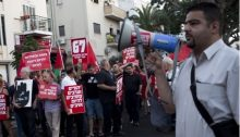Newly appointed Haifa Deputy Mayor Raja Zaatry (right) addresses participants in a march in the northern city demonstrating against the occupation of the Palestinian territories.
