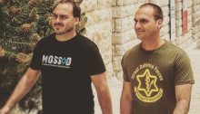 Militaristic machismo: Jair Bolsonaro's two sons, Eduardo and Carlos, during their trip to Israel in May 2016. Eduardo, right, posted to social media this photo of himself and his brother sporting Israel army and Mossad T-shirts.
