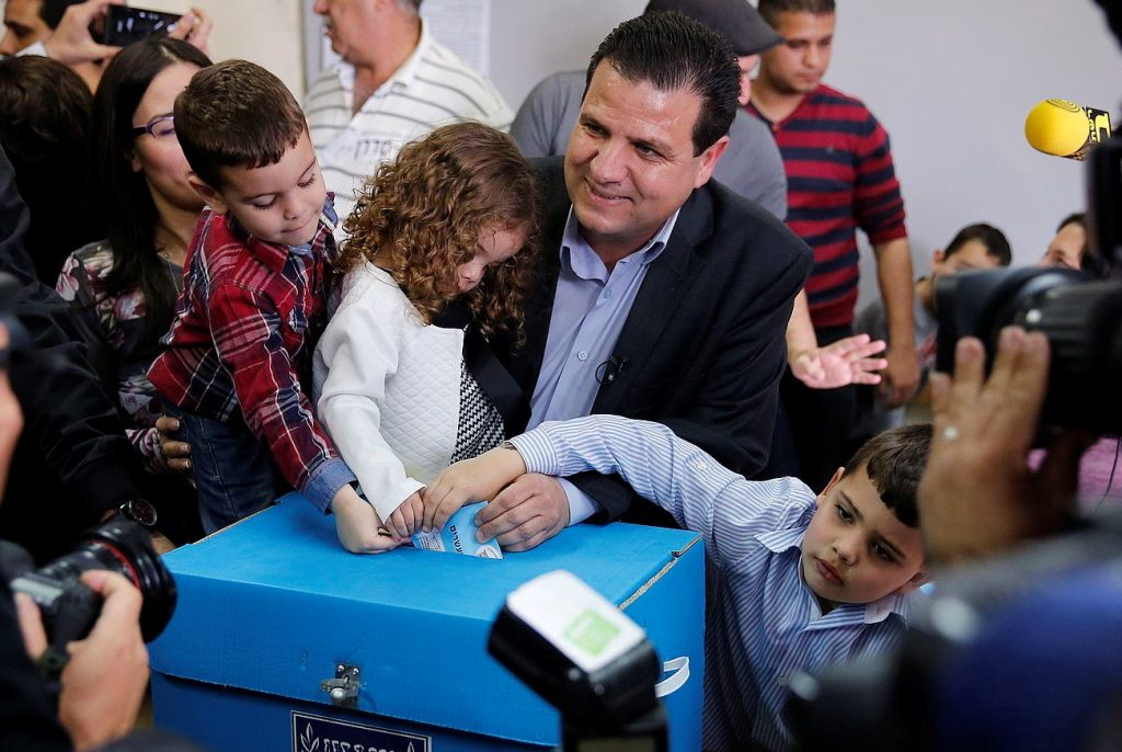Ayman Odeh casting his ballot with his young family on March 17, 2015, in the general elections for the 20th Knesset