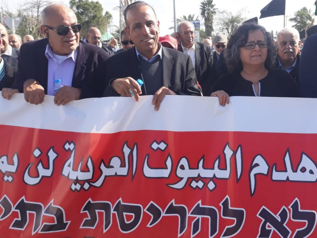Among the demonstrators against the pending demolition of 17 homes in Qalansawe, last Friday, February 8, were Hadash MK Aida Touma-Suleiman, right, and Hadash Secretary General Mansour Dehamshe, center