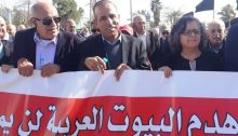 Among the demonstrators against the pending demolition of 17 homes in Qalansawe, last Friday, February 8, were Hadash MK Aida Touma-Suleiman, right, and Hadash Secretary General Mansour Dehamshe, center (Photo: Zu Haderech)