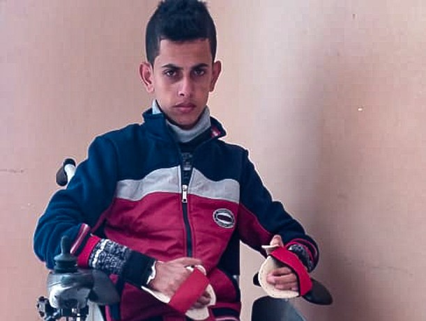 Attiya Nabaheen, paralyzed and confined to a wheelchair for the rest of his life, after he was shot by Israeli armed forces in Gaza on his 15th birthday