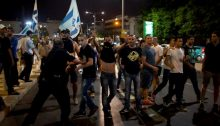 Lehava-Kach members attacking a demonstration against Israel's brutal Protective Edge military campaign in Gaza that was held at the Habima Square, Tel Aviv, July 2014