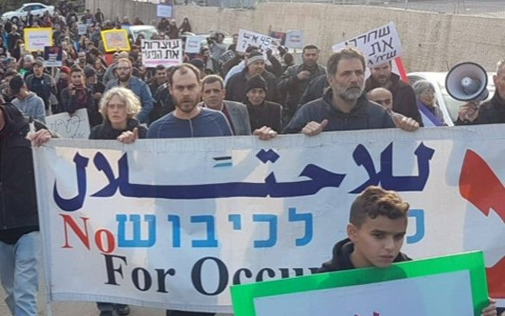 Demonstrators march in occupied East Jerusalem to protest the eviction of the Palestinian Sabbagh family from its home in Sheikh Jarrah.
