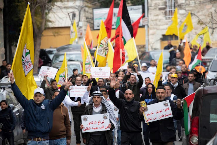 Hundreds of Palestinian, Israeli and international protesters march in Hebron to demand the end of settlements and segregation in the city, February 22, 2019.