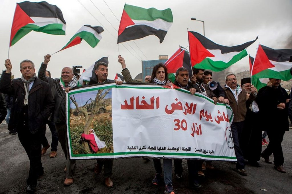 Palestinians take part in a Land Day demonstration held in the city of Al-Bireh just south of the Israeli settlement of Beit El, in the occupied West Bank on March 30, 2019.
