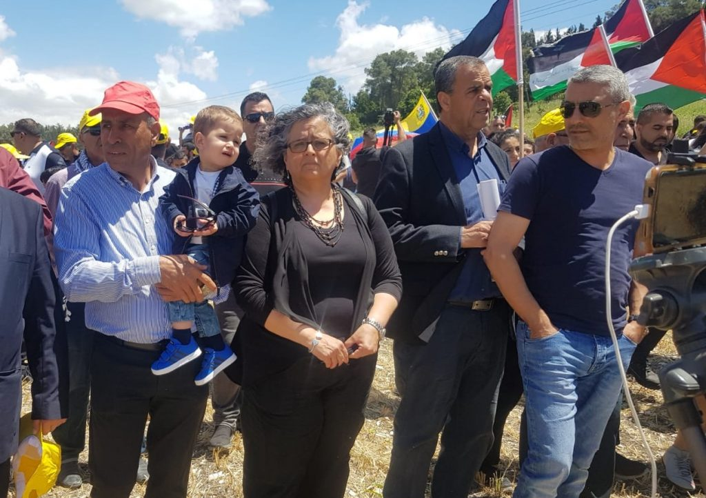 Hadash Secretary General Mansour Dahamshe (first from left) and MK Aida Touma-Sliman (center) during the Nakba Day march to Khubbayza