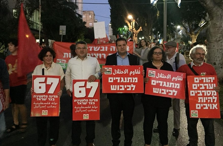 Hadash MKs Youssef Jabareen (second from left), Ayman Odeh (center) and Aida Touma-Sliman (second from right) during the protest march, Tuesday, May 14, in Tel Aviv
