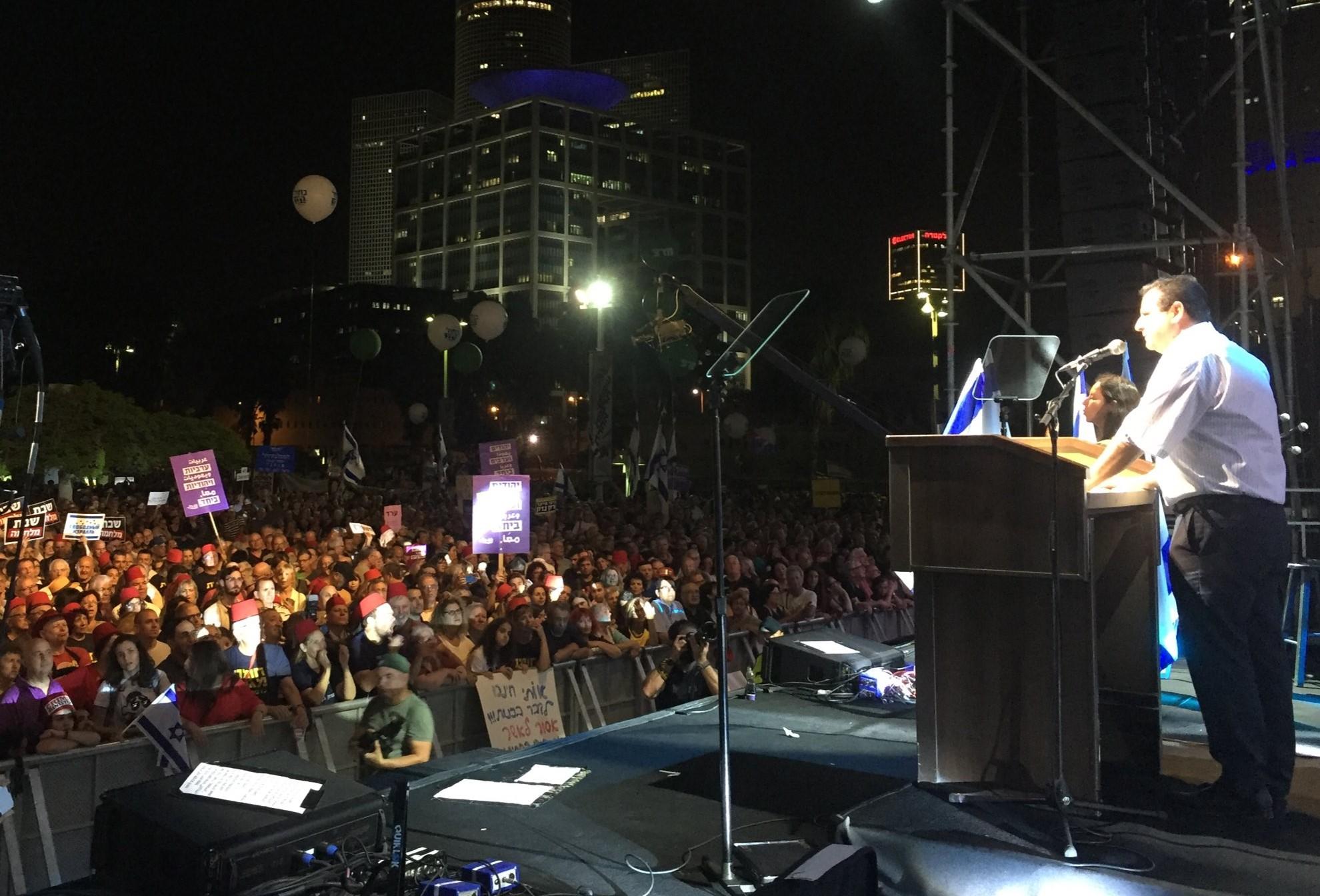 MK Ayman Odeh addresses the mass of demonstrators on Saturday night, May 25, in Tel Aviv.