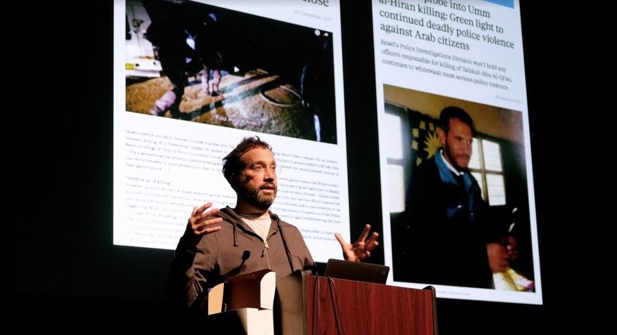 Prof. Eyal Weizman of Goldsmiths, University of London, during his presentation of the conclusions of Forensic Architecture's investigation into the events at Umm al-Hiran; at right, a photograph of the Bedouin teacher, Yacoub Mousa Abu al-Qee'an, taken in his classroom