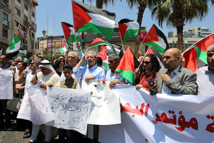 "Palestinians marched through Ramallah on Saturday, June 15, to protest the US-sponsored economic workshop scheduled for today and tomorrow, June 25-26, in Bahrain as part of the Trump administration's ""Deal of the Century"" plan for ending the conflict."
