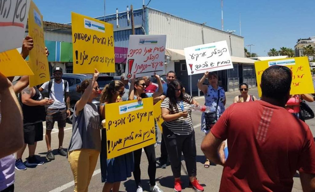 Arkia workers demonstrate at Tel Aviv's Sde Dov airport to protest the planned lay off of 250 of the company's employees.