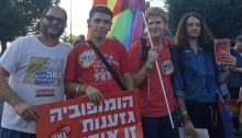 """Hadash MK Ofer Cassif, left, with Young Communist League activists at the Gay Pride Parade held last week in Rehovot; the placard reads: """"Homophobia [and] Racism are the same violence."""""""