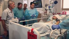 MK Ofer Cassif (second from left), in tears, beside MK Ayman Odeh, during their visit to the bedside of Abd Rahman Shteiwi in the intensive care unit at Sheba Hospital in Tel Hashomer, Saturday, July 20