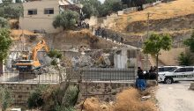 Armed Israeli Border Police forces indifferently secure the site of a house demolition in Sur Baher, last Friday, July 19, 2019.